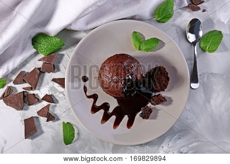 Chocolate fondant with mint on plate