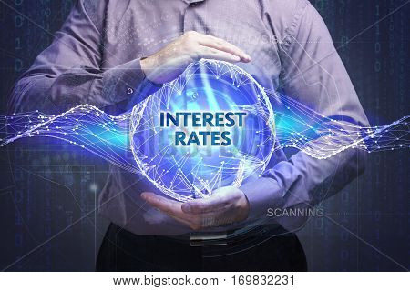 Business, Technology, Internet And Network Concept. Young Businessman Shows The Word: Interest Rates