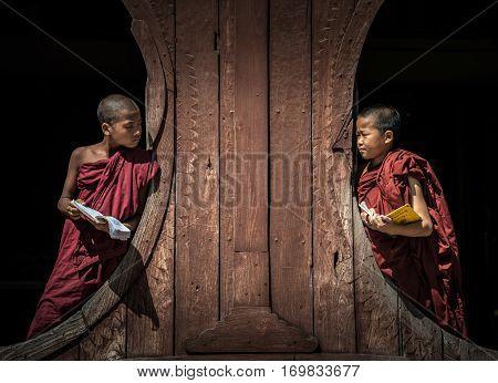NYAUNGSHWE, MYANMAR - OCT 05 2014: Myanmar novice in the Shwe-Yaunghwe monastery the big window temple in Myanmar.