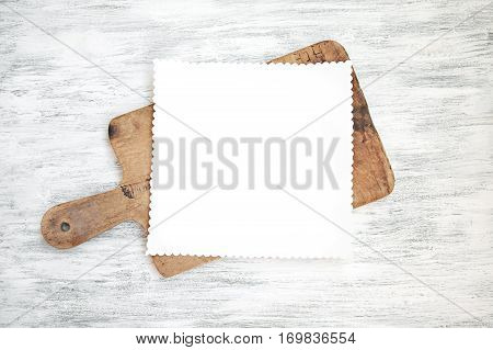 Empty clear menu template on chopping board on wood background