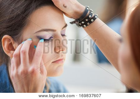 Make up artist working in art studio
