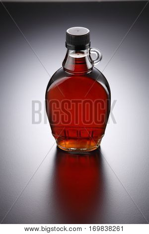 bottle of pure maple syrup