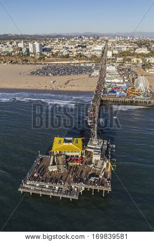 Santa Monica, California, USA - December 17, 2016:  Aerial of weekend crowds enjoying Santa Monica Pier near Los Angeles California.