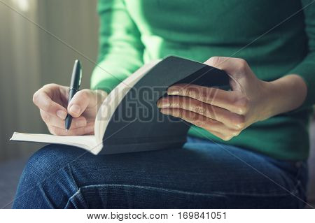 Young Woman Taking Notes At Comfy Home