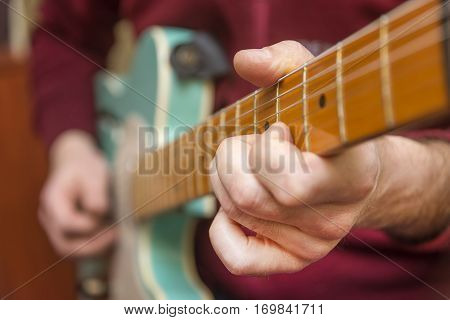 Close Up Shot Of A Man Playing Electric Guitar.