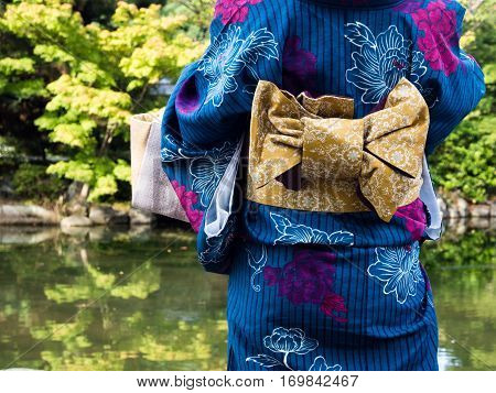 Woman in Japanese kimono with traditional obi belt