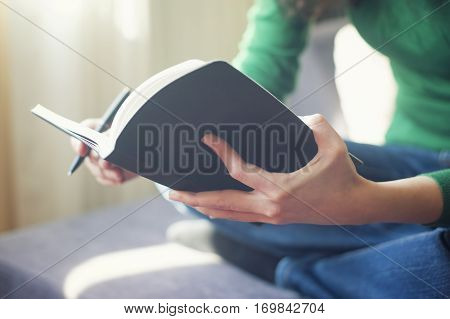 Woman Holding A Notebook At Her Hands