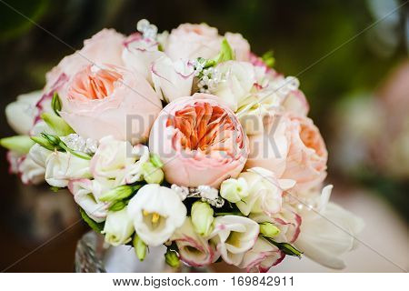 Bridal bouquet with pink and white peony roses of different size, decorative beads isolated. Romantic wedding bouquet with beautiful flowers. Elegant round bunch of fresh plants. Accessory of bride