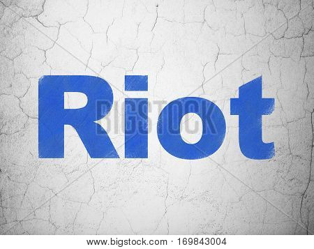 Political concept: Blue Riot on textured concrete wall background