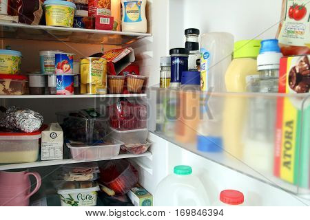 Camberley, UK - Feb 1st 2017: Contents of a packed domestic UK fridge or refrigerator full of British supermarket food from England