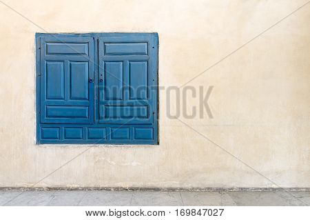 Vintage blue wooden embedded cupboard of a old historic building and vintage plaster wall Medieval Cairo Egypt