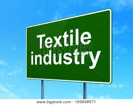 Manufacuring concept: Textile Industry on green road highway sign, clear blue sky background, 3D rendering