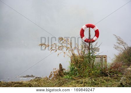 Lifebuoy with misty river. Fog on the river.