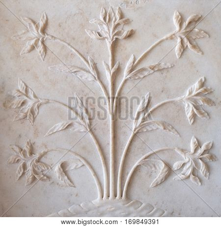 AGRA, INDIA - FEBRUARY 14: Mughal stone art on the facade of the Taj Mahal (Crown of Palaces), an ivory-white marble mausoleum in Agra, Uttar Pradesh, India on February 14, 2016.