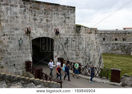 People Walking Out Of The Entrance In La Cabana Fortress