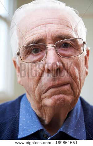 Portrait Of Senior Man Suffering From Stroke