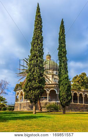 Catholic monastery and a small church Mount Beatitudes. Dome and colonnade surrounded by cypress. Israel, the shores of Lake Kinneret
