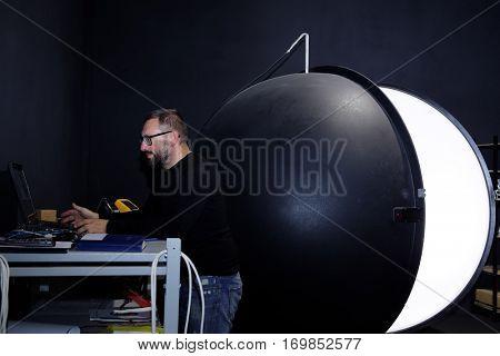 ST. PETERSBURG, RUSSIA - NOVEMBER 30, 2016: General director of Vitrulux Bronislav Gorlinsky at the 2 m integrating sphere. Vitrulux is one of leading companies in development of lighting solutions