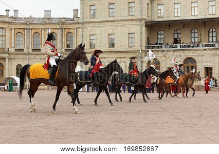 GATCHINA, ST. PETERSBURG, RUSSIA - SEPTEMBER 10, 2016: Horse carousel show on the platz in front of Gatchina palace during the festival Gatchinskaya Byl. The festival is held first time this year