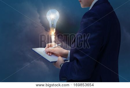 Businessman Writes Down The Idea. New Stsrt Up.