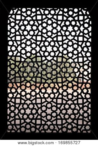 DELHI, INDIA - FEBRUARY 13: Intricate carving of stone window grill at Humayun's Tomb, built by Hamida Banu Begun in 1565-72, Delhi, India on February 13, 2016.