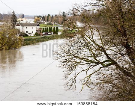 Snoqualmie river floods near the city of Duvall farmlands and roads under water