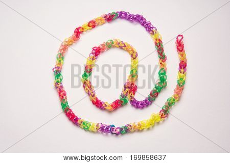 Rubber band chain on white background. Office supplies. Assortment of stationery.