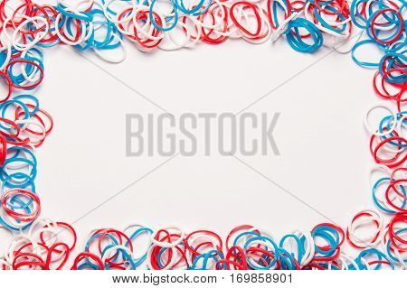 Rubber bands on white background. Office supplies. Assortment of stationery.