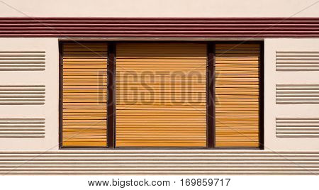Closed window with brown wooden shutters, background