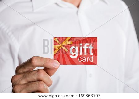 Close-up Of A Man Holding Prepaid Gift Card