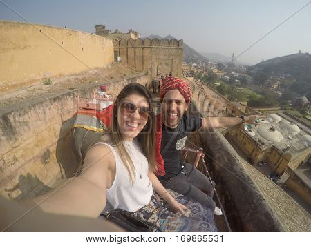Couple talking a selfie in Elephant in Amber Fort, Jaipur, India - with Gopro Camera