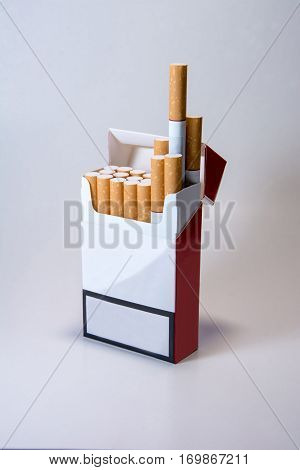A pack of cigarettes on a white background. Smoking is harmful. Smoking causes death. Nails in the coffin.