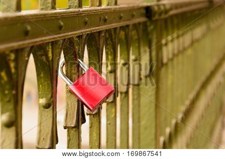 Valentine Love Lock. Lock as a symbol of love. Red padlock on the railing. Sign of infatuation. Valentine's Day