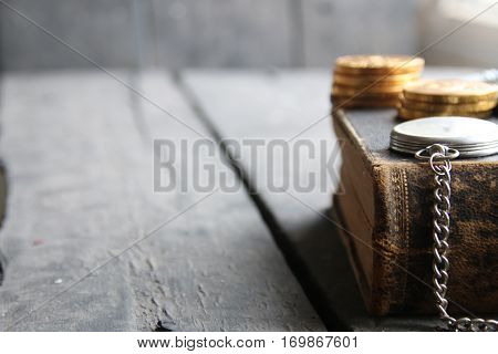 student loan concept, old book on wooden vintage table