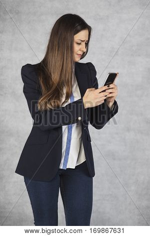 Woman Writing Sms, Dissatisfied With The Speed Of Data Transfer