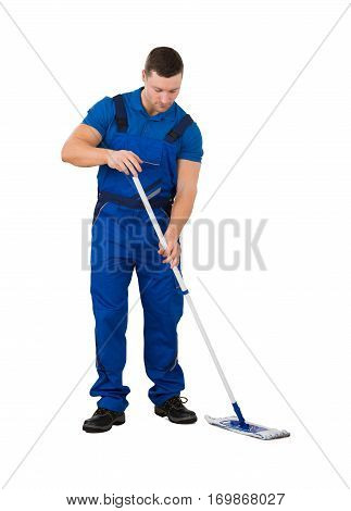 Young Male Janitor Cleaning Floor With Mop On White Background