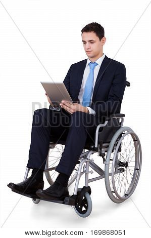 Handicapped Businessman Using Digital Tablet On White Background