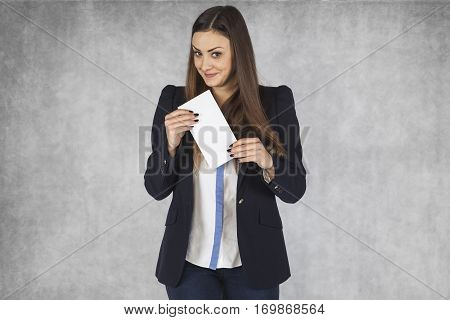 Happy Business Woman Holds A Bribe