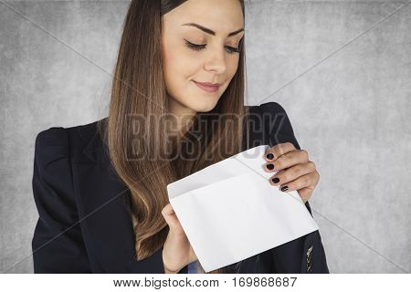 Business Woman Looks Into The Envelope