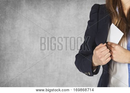 Business Woman Puts An Envelope In His Pocket, Copy Space Next To