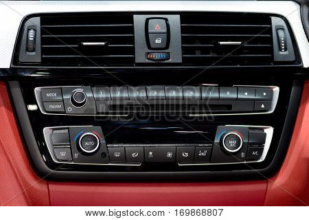 Car instrument panel console and stereo radio with air condition panel in car.