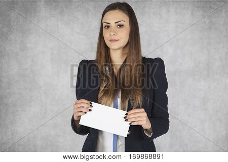Business Woman Holds In His Hands An Envelope