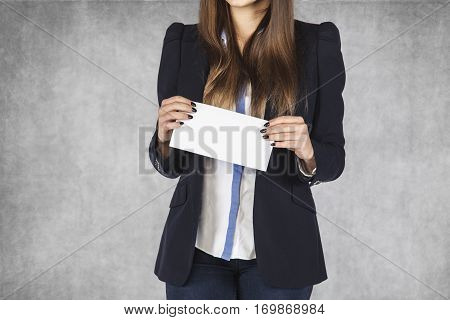 Envelope With A Bribe In The Hands Of A Business Woman