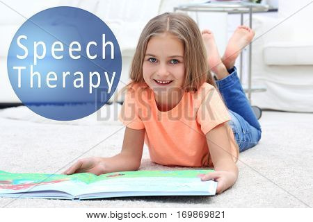 Little girl with book at home. Text SPEECH THERAPY on background