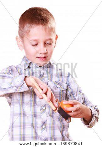 Young Boy Use Sling Shot Shoot Mandarine.