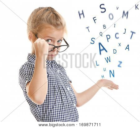 Little girl in glasses and alphabet letters on white background. Speech therapy concept
