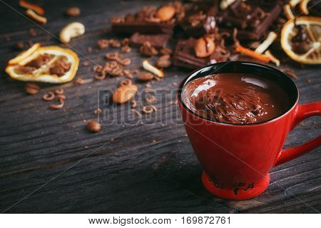 Chocolates background. Chocolate. Cup of hot chocolate lemon nuts and assortment of fine chocolates in dark and milk chocolate on dark wooden table