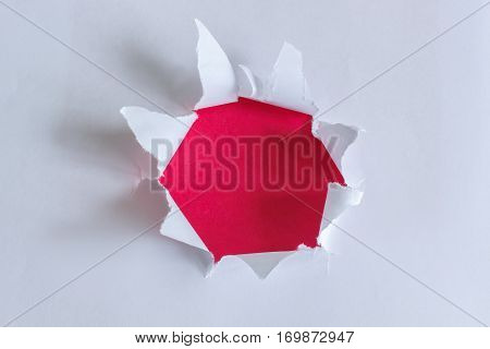 Torn paper with red background design concept.