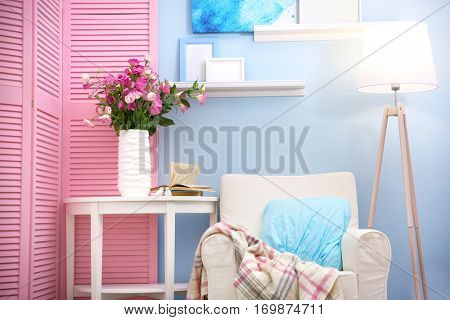 Beautiful room interior with pink folding screen