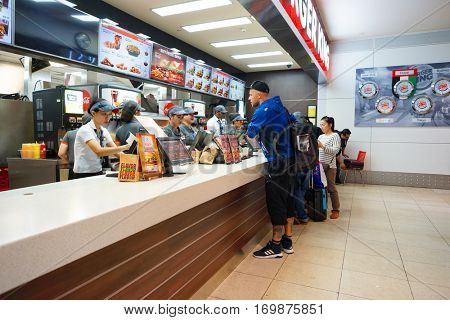 DUBAI, UAE - CIRCA NOVEMBER, 2016: Burger King restaurant at Dubai International Airport. Burger King is an American global chain of hamburger fast food restaurants.